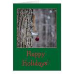 Ardilla con las tarjetas de felicitación del navid