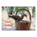 Ardilla de Santa en cesta del navidad Nevado Felicitaciones