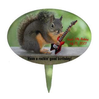Ardilla que toca la guitarra eléctrica palillos de tarta