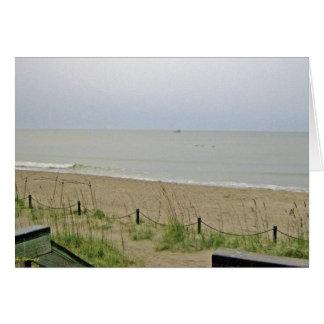 Área abandonada de la playa felicitaciones