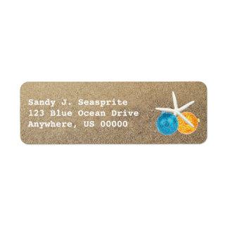 Arena de la playa y etiquetas del remite de los or etiqueta de remite