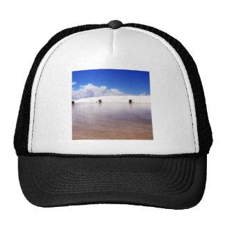Arena del blanco de la playa gorro