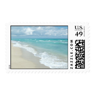 Arena extrema del blanco de la opinión de la playa timbre postal