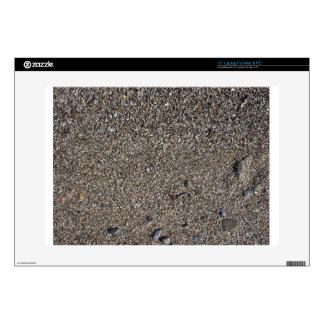 Arena mojada y pequeñas piedras con los fragmentos calcomanías para 38,1cm portátiles