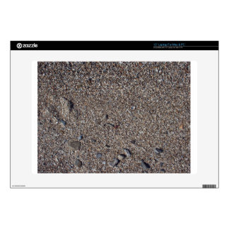 Arena mojada y pequeñas piedras con los fragmentos skins para 38,1cm portátil