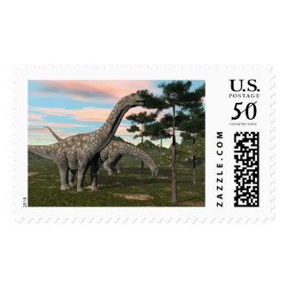 Argentinosaurus dinosaur eating tree - 3D render Postage