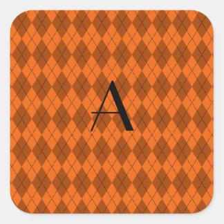 Argyle del naranja del monograma