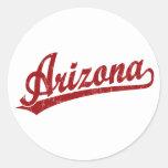 Arizona script logo in red round stickers