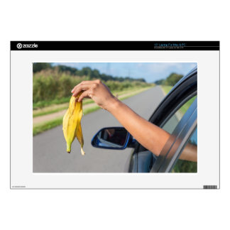 "Arm dropping peel of banana out car window skin for 15"" laptop"