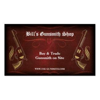 Arma del revólver y tarjeta de visita de cuero roj