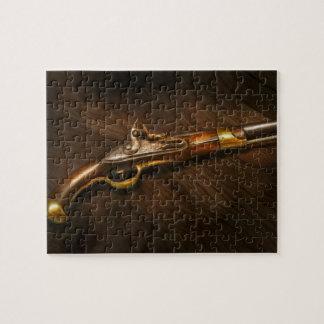 Arma - pistolas en el amanecer puzzle con fotos
