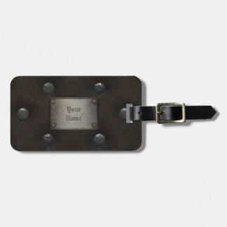 Armadura de cuero tachonada con la placa etiqueta de equipaje
