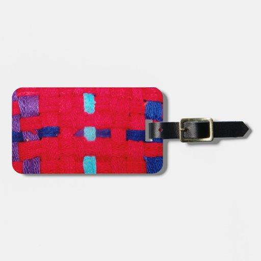Armadura del rojo, púrpura y azul etiqueta de equipaje