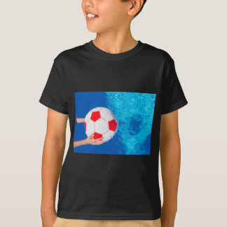 Arms holding beach ball above swimming pool water T-Shirt
