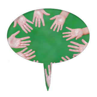 Arms of children together in circle on green cake topper