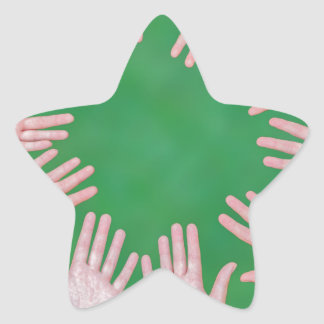 Arms of children together in circle on green star sticker