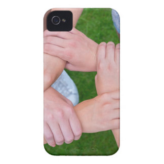 Arms with hands of children holding together iPhone 4 case