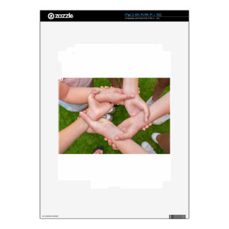 Arms with hands of girls holding each other decals for the iPad 2
