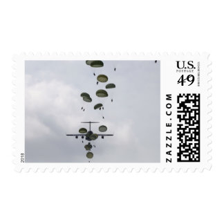 Army Soldiers jump out of a C-17 Globemaster II Postage