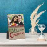 Arpillera y placa roja de la foto del navidad de
