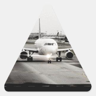Arplane on runway for take off triangle sticker