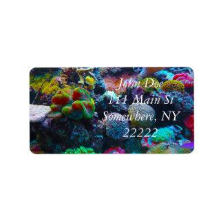 Arrecife de coral magnífico etiqueta de dirección