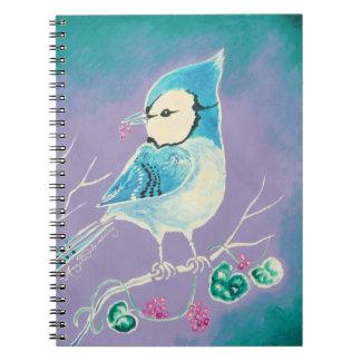 Arrendajo azul en rama con las bayas libro de apuntes