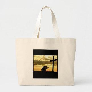 Arrodillamiento en la cruz bolsas
