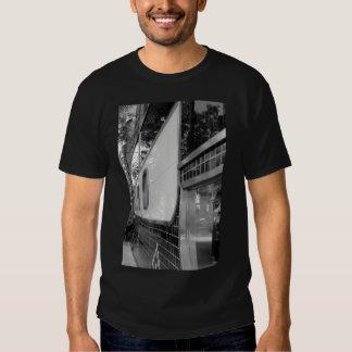 Art déco que construye la camiseta de los hombres remeras