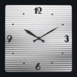 "Art Deco Silver Satin Stripes Square Wall Clock<br><div class=""desc"">An elegant Art Deco geometric striped pattern clock in a silver / chrome satin gradient,  with a slight,  raised,  3-d effect and large black numbers in a Deco font</div>"