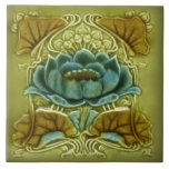 """Art Nouveau Lotus Repro of Glazed Antique Tile<br><div class=""""desc"""">The Art Nouveau style began in the last decade of the 19th century and lasted until WWI. Art Nouveau is,  in many ways,  an outgrowth of the Arts &amp; Crafts movement. Art Nouveau tiles feature stylized designs with flowing curves based on natural forms.</div>"""
