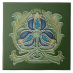 """Art Nouveau Pomegranate Repro Tile Blues &amp; Greens<br><div class=""""desc"""">The Art Nouveau style began in the last decade of the 19th century and lasted until WWI. Art Nouveau is,  in many ways,  an outgrowth of the Arts &amp; Crafts movement. Art Nouveau tiles feature stylized designs with flowing curves based on natural forms.</div>"""