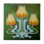 """Art Nouveau Tulip Trio Antique Reproduction Ceramic Tile<br><div class=""""desc"""">This tile is reproduced from an actual antique tile dating to around 1900. Gorgeous colors of yellow and light blue on dark green. Available in 4"""" and 6"""" tiles as well as other items. Art Nouveau tiles are not only highly collectible, they also make great wall tiles, backsplashes, fireplace surrounds,...</div>"""