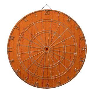 Art orange forest dartboard with darts