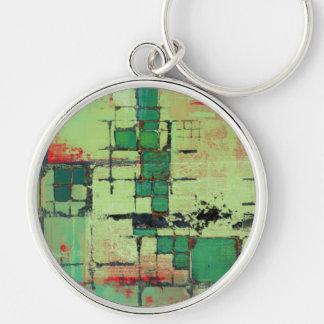 Arte abstracto del enrejado verde llavero redondo plateado