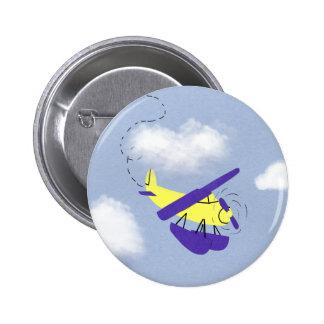 Arte amarillo y azul del aeroplano del dibujo anim pin redondo 5 cm