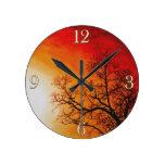 Arte ardiente de la puesta del sol y de la natural relojes de pared