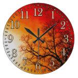 Arte ardiente de la puesta del sol y de la natural reloj de pared