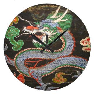 Arte asiático colorido brillante del dragón relojes