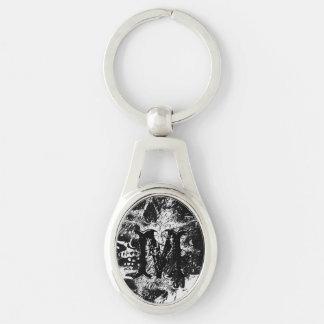 arte blanco y negro del collage de los cráneos llavero plateado ovalado