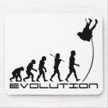 Arte de la evolución del deporte del salto con pér alfombrilla de ratones