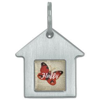 Arte de la mariposa en rojo de la página del placa de mascota