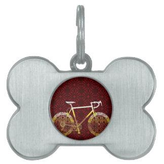 Arte de oro del vector de la bicicleta placa de nombre de mascota