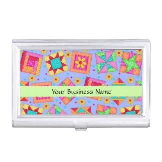 Arte del bloque del remiendo del edredón en fondo caja de tarjetas de visita