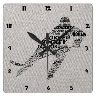 Arte del texto de las idiomas del hockey sobre hie reloj de pared