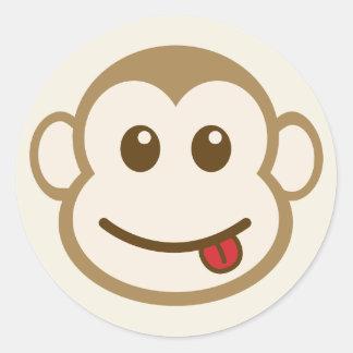 Arte del vector de la cara del mono pegatina redonda