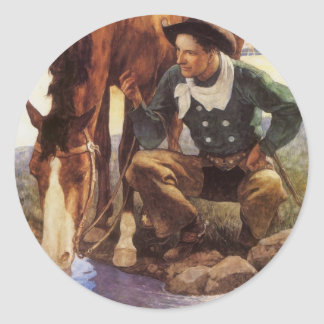 Arte del vintage, vaquero que riega su caballo por pegatina redonda