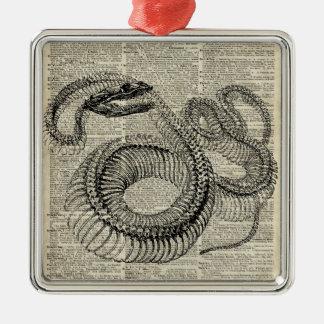 Arte esquelético de la página del diccionario del adorno navideño cuadrado de metal