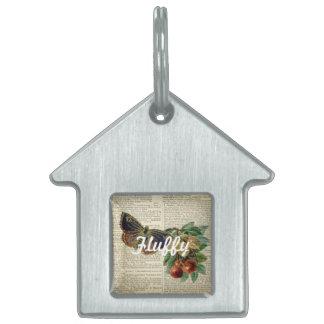 Arte floral de la mariposa en la página del placa de mascota