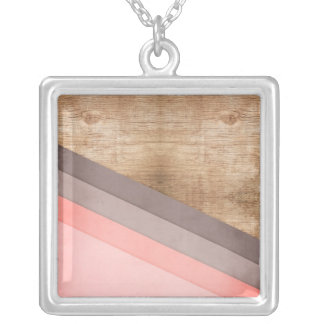 Arte geométrico de madera collar plateado